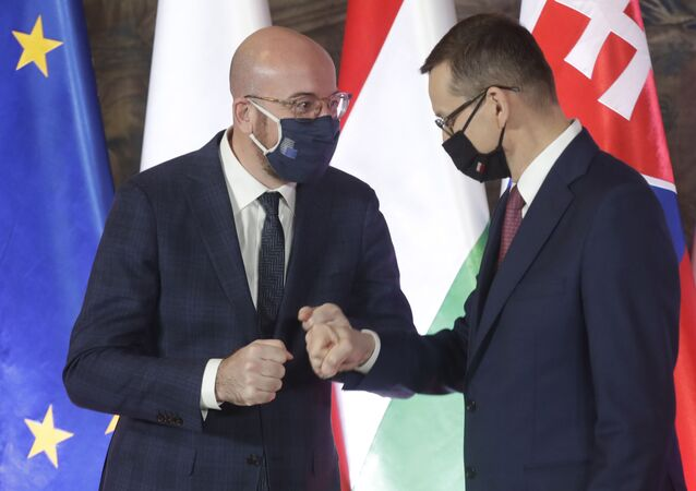 European Council President Charles Michel, left, and Poland's Prime Minister Mateusz Morawiecki during welcoming ceremony ahead of a ceremonious meeting that marks 30 years of central Europe's informal body of cooperation between Poland, Hungary, Slovakia and The Czech Republic, called the Visegrad Group, at the Wawel Castle in Krakow, Poland, Wednesday, Feb. 17, 2021