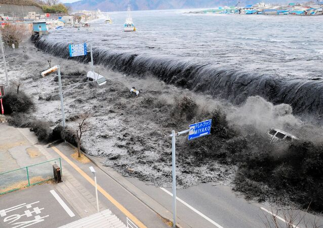 A wave from the Heigawa estuary in Iwate Prefecture approaches Miyako City after the 8.9 magnitude earthquake struck the area on 11 March 2011.