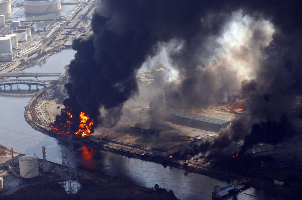 Flames engulf buildings in an industrial complex in Sendai, northern Japan, Saturday, 12 March 2011. Japan launched a huge military rescue operation Saturday after a giant, quake-fed tsunami killed hundreds of people and turned the northeastern coast into a swampy wasteland, while authorities braced for a possible meltdown at a nuclear reactor.