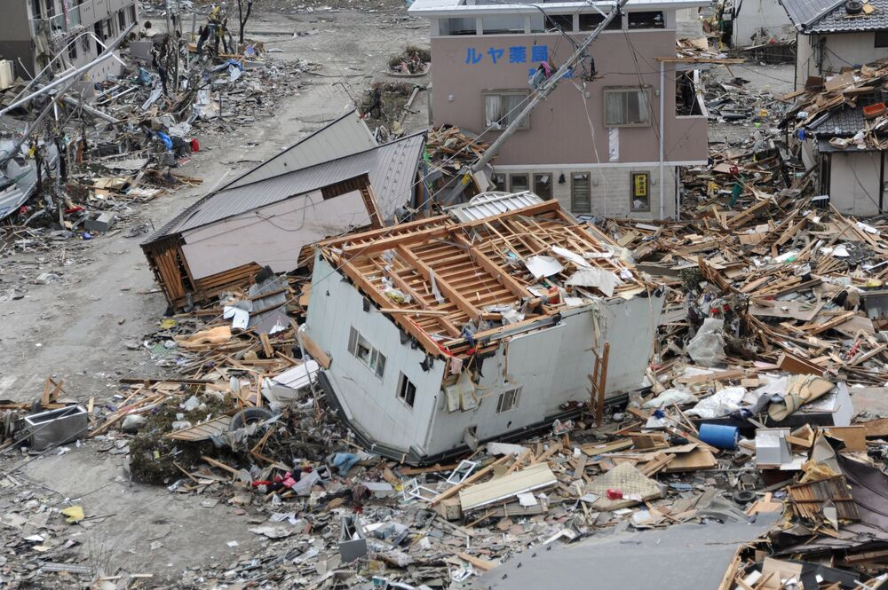 An upended house is seen among the debris in Ofunato, Iwate Prefecture, in this US Navy handout photo dated 15 March 2011.