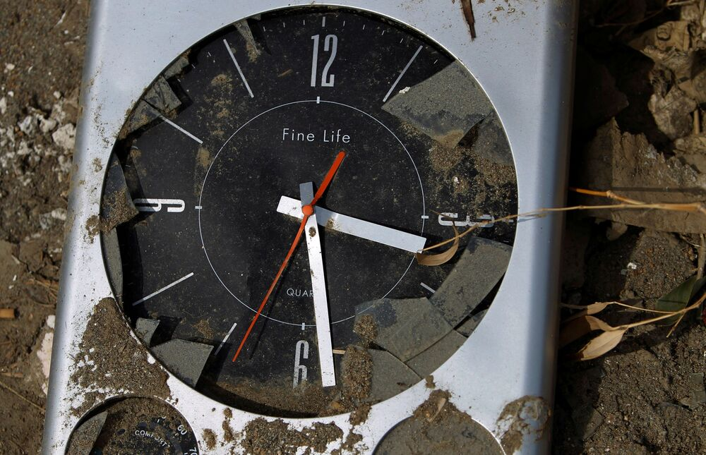 A clock that stopped as the 11 March tsunami hit the area is seen in Rikuzentakata, Iwate prefecture, 7 April 2011.