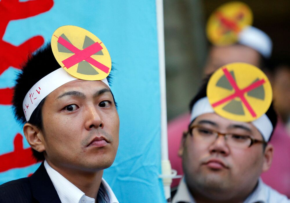 Protesters wear anti-nuclear headbands at a rally against possibly restarting nuclear reactors in Tokyo 6 June 2012.