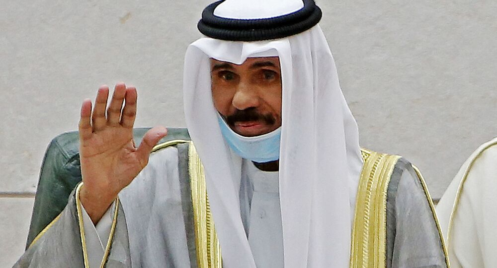Emir of Kuwait Sheikh Nawaf al-Ahmad al-Jaber al-Sabah gestures in greeting as he arrives to attend the opening of the 5th regular session at the country's National Assembly (parliament) in Kuwait City on October 20, 2020