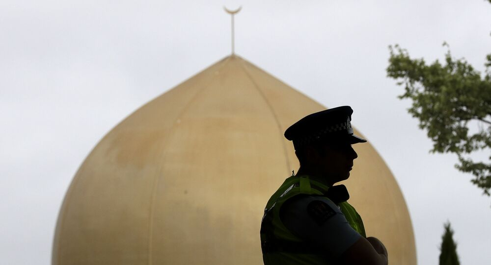 A police officer stands in a park near the Al Noor mosque in Christchurch, New Zealand, Sunday, March 15, 2020