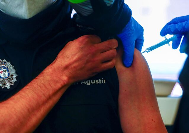 A police officer receives his first dose of the AstraZeneca COVID-19 vaccine, as the coronavirus disease (COVID-19) outbreak continues, at Atletico Madrid's Wanda Metropolitano stadium in Madrid, Spain, February 25, 2021