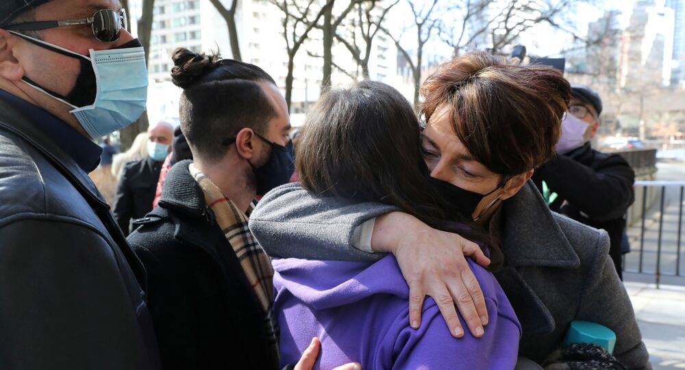 Relatives of those who died when Alex Minassian drove a van into a crowd of shoppers in Toronto in 2018 hug outside court