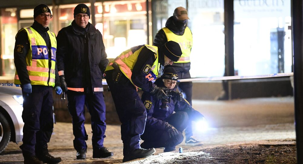 Police investigators work at the scene where a man attacked eight people with a sharp weapon, seriously injuring two, in the Swedish city of Vetlanda on 3 March 2021.