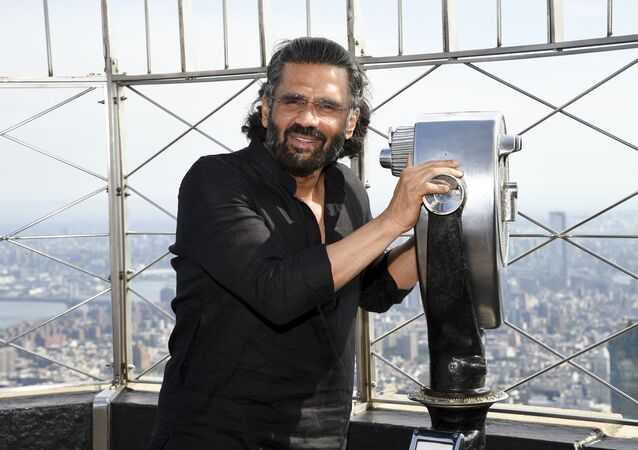 Indian actor Suniel Shetty participates in the ceremonial lighting of the Empire State Building to celebrate India Day on Thursday, Aug. 15, 2019, in New York