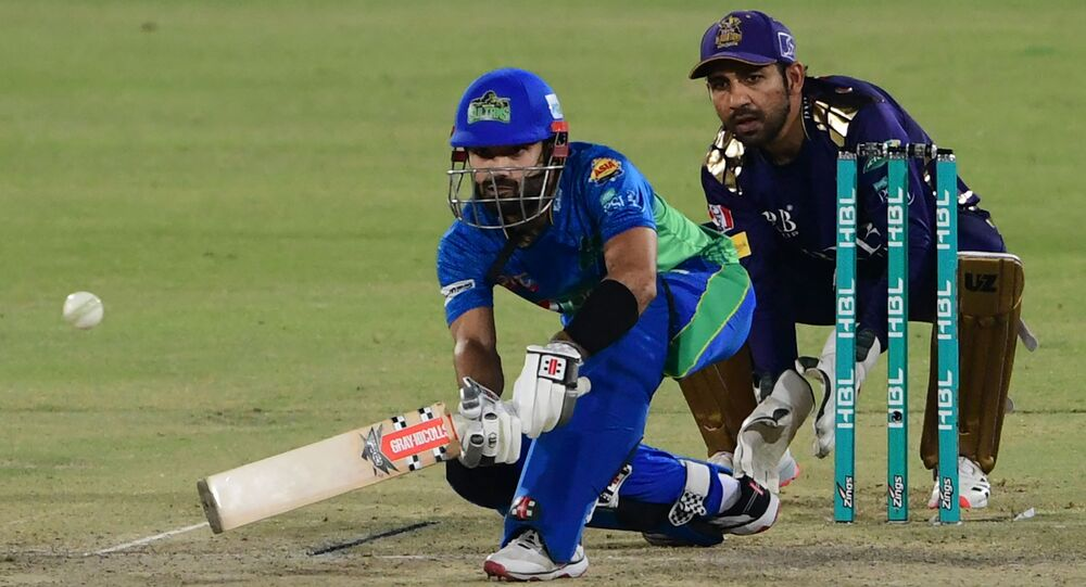 Multan Sultans' Mohammad Rizwan (L) plays a shot during the Pakistan Super League (PSL) T20 cricket match between Quetta Gladiators and Multan Sultans at the National Stadium in Karachi on March 3, 2021