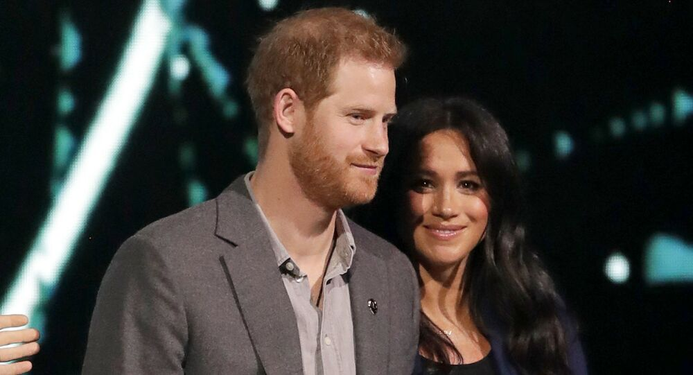Meghan, Duchess of Sussex, is brought on stage by Britain's Prince Harry during his speech at WE Day UK, a global initiative to encourage young people to take part in social change at the SSE Arena in Wembley, London, Wednesday, 6 March 2019.
