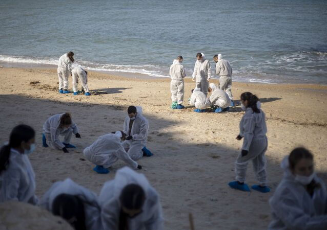 In this Monday, Feb. 22, 2021 file photo, Israeli soldiers wearing protective suits clean tar from a beach after an oil spill in the Mediterranean Sea in Sharon Beach Nature Reserve, near Gaash, Israel. Israeli authorities said they believed a tanker suspected of smuggling oil from Iran to Syria was responsible for spilling tons of crude into the Mediterranean last month, causing one of Israel's worst environmental disasters.