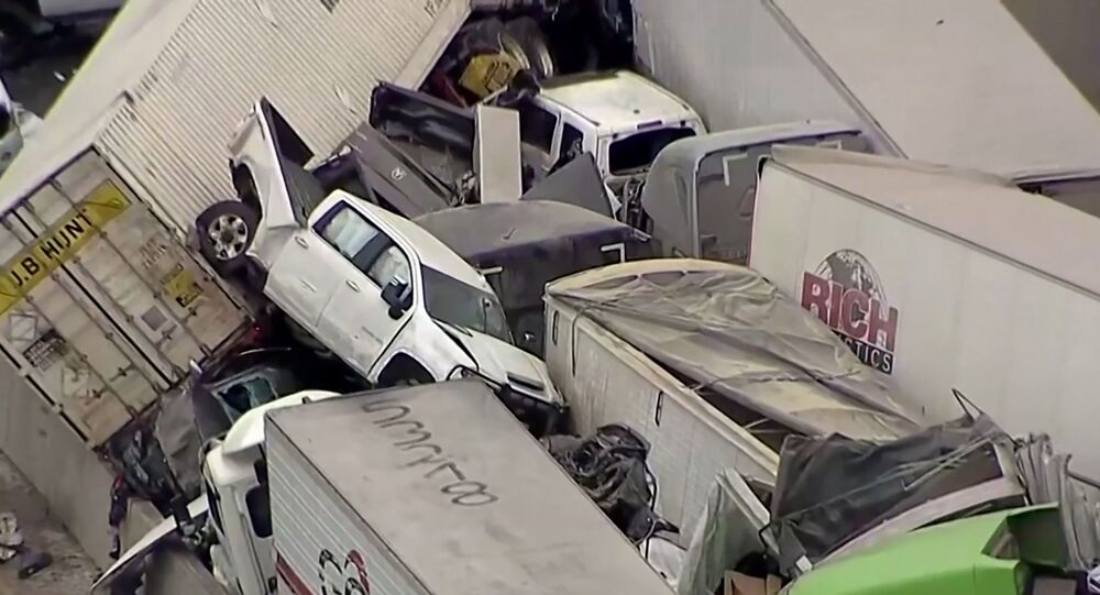 Cars and trucks are wedged together after a morning crash on the ice covered I-35 in Fort Worth