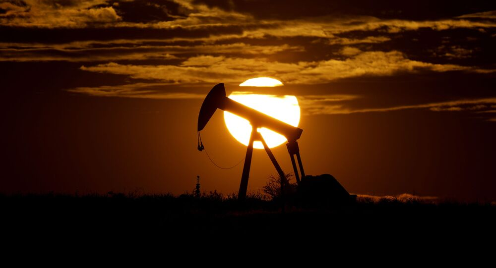 In this Wednesday, April 8, 2020, file photo, the sun sets behind an idle pump jack near Karnes City, Texas. Demand for oil continues to fall due to the new coronavirus outbreak.
