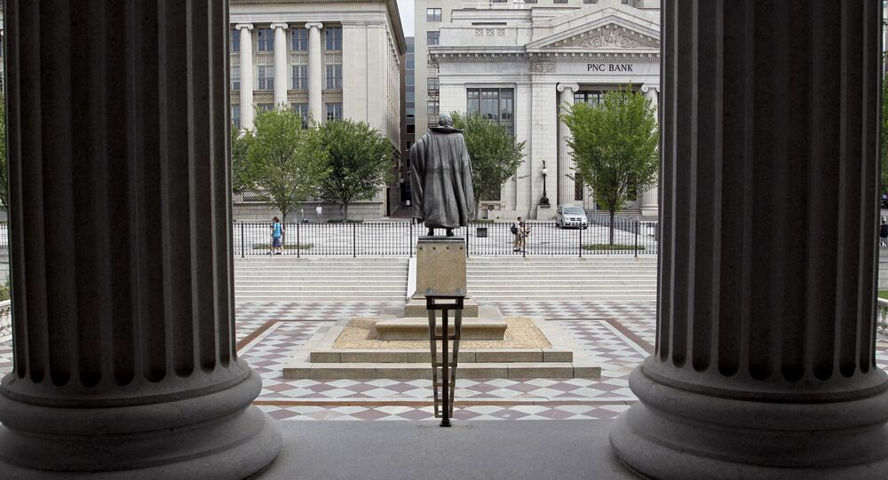 In this Aug. 17, 2010 file photo, a statue of the Albert Gallatin, the 4th Secretary of the Treasury, stands on the north patio of the US Treasury Building in Washington