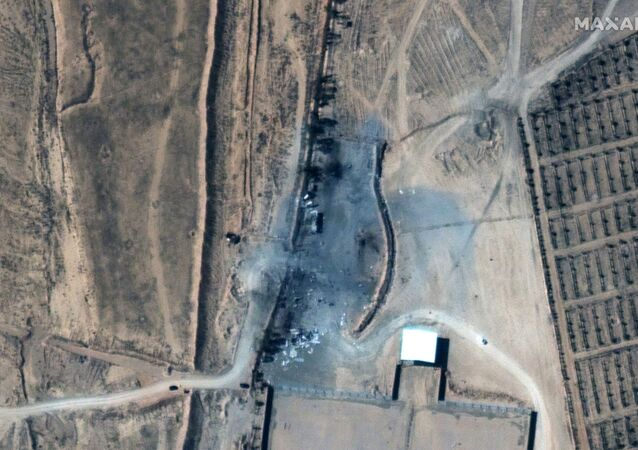 A close up view of destroyed buildings at an Iraq-Syria border crossing after airstrikes, seen in this February 26, 2021 handout satellite image provided by Maxar.