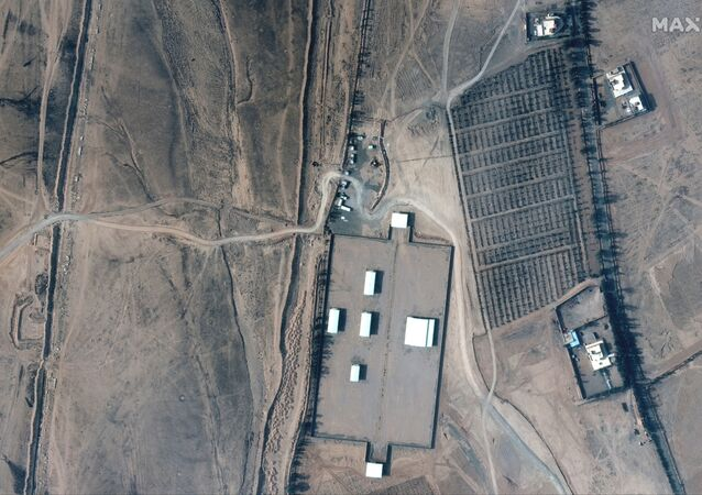 A closer view of an Iraq-Syria border crossing and buildings before airstrikes, seen in this February 3, 2021 handout satellite image provided by Maxar.