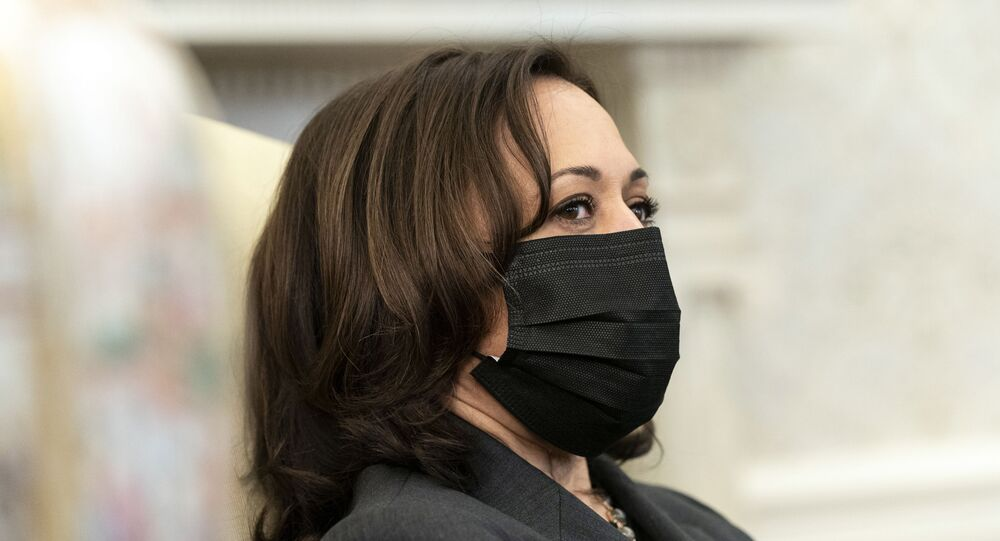 Vice President Kamala Harris listens as President Joe Biden speaks during a meeting about cancer in the Oval Office of the White House, Wednesday, March 3, 2021, in Washington.