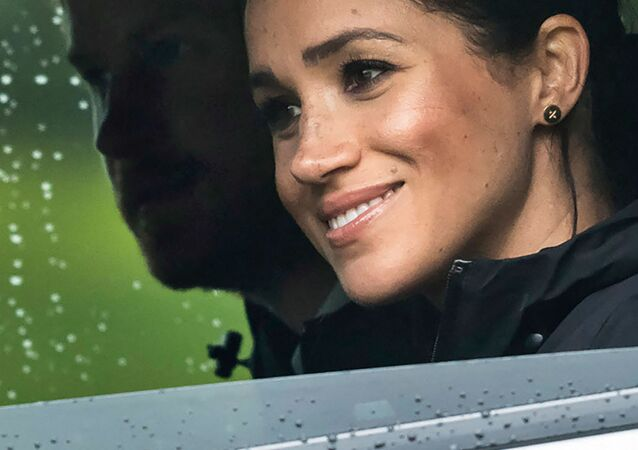 (FILES) In this file photo Britain's Prince Harry and his wife Meghan, Duchess of Sussex arrive for the unveiling of a plaque dedicating 20 hectares of native bush to the Queen's Commonwealth Canopy project at The North Shore Riding Club in Auckland on October 30, 2018