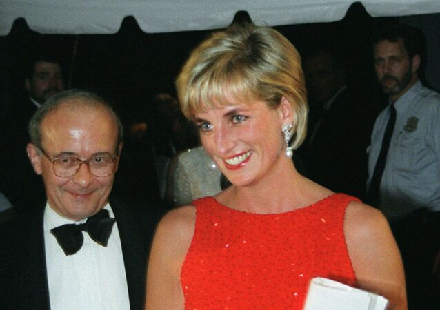 England's Princess Diana leaves a Red Cross gala Tuesday, June 17, 1997 at the National Museum of Women in the Arts in Washington followed by Ambassador John Kerr of Great Britain