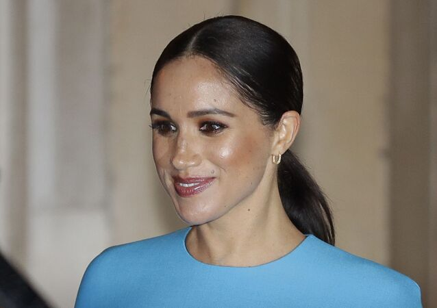 In this file photo dated Thursday, 5 March 2020, Meghan, the Duchess of Sussex, leaves after attending the annual Endeavour Fund Awards in London.