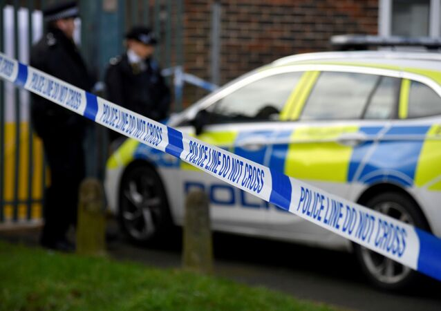 Police officers stand outside the scene of a fatal stabbing as British police said they were investigating at least five separate serious violent incidents in south London late on Friday, Croydon, London, Britain, February 6, 2021