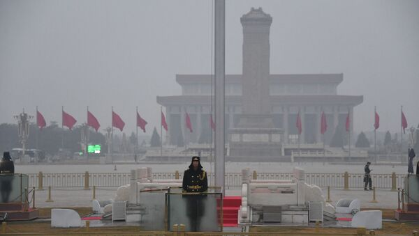 A Chinese soldier stands guard in Tiananmen Square before the opening session of the National People's Congress at the adjacent Great Hall of the People (not pictured) in Beijing on March 5, 2021.  - Sputnik International