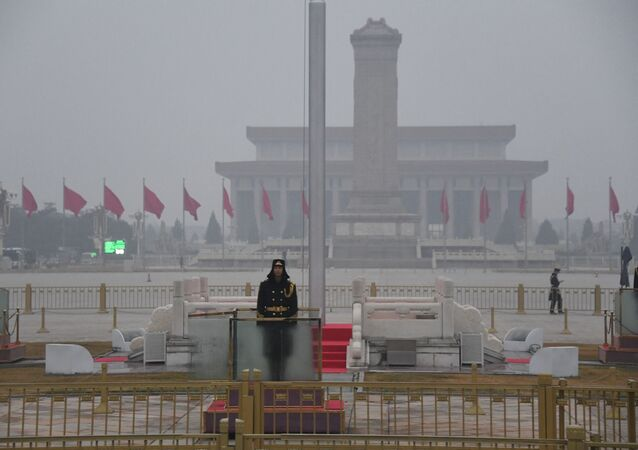 A Chinese soldier stands guard in Tiananmen Square before the opening session of the National People's Congress at the adjacent Great Hall of the People (not pictured) in Beijing on March 5, 2021.