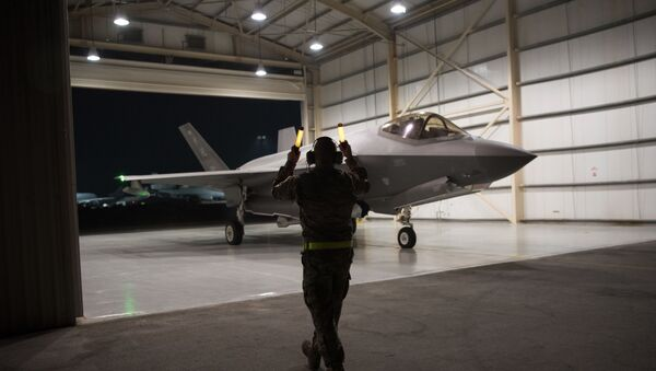 In this Sept. 10, 2019, photo released by the U.S. Air Force, an F-35A Lightning II fighter jet is directed out of a hangar at Al-Dhafra Air Base in the United Arab Emirates. - Sputnik International