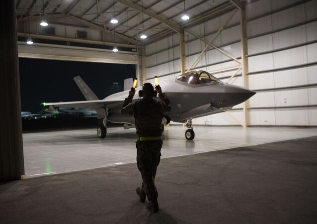 In this Sept. 10, 2019, photo released by the U.S. Air Force, an F-35A Lightning II fighter jet is directed out of a hangar at Al-Dhafra Air Base in the United Arab Emirates.