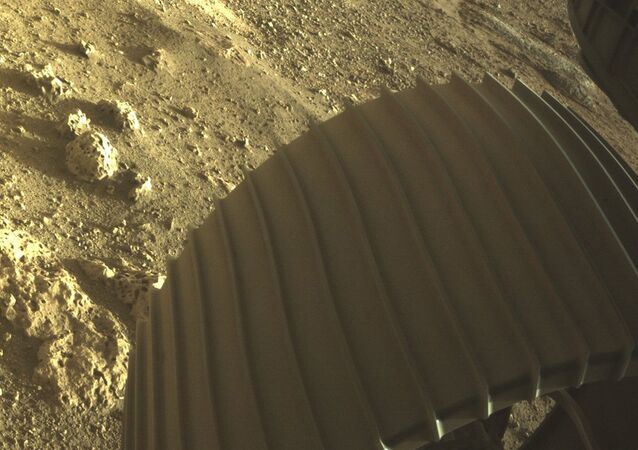 This photo provided by NASA shows one of the six wheels on the Perseverance Mars rover, which landed on Thursday, Feb. 18, 2021.