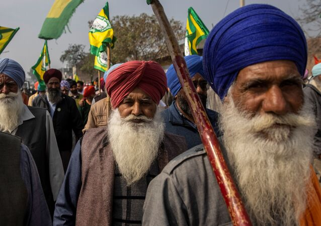 Farmers and agricultural workers arrive to attend a rally against farm laws, in Barnala, northern state of Punjab, India, February 21, 2021.
