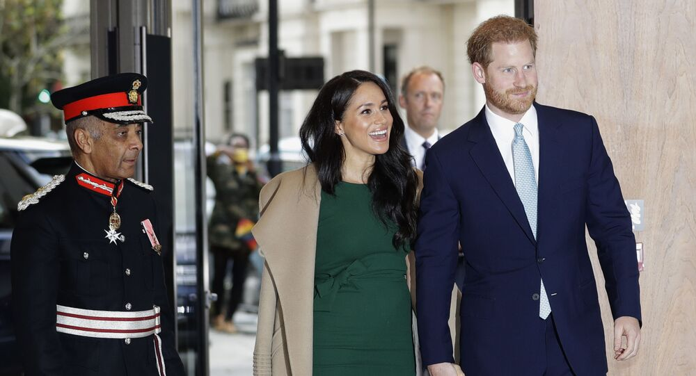 In this 15 October 2019 file photo, Britain's Prince Harry and Meghan, the Duke and Duchess of Sussex, arrive to attend the WellChild Awards Ceremony in London