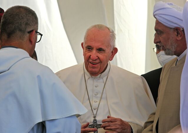 Pope Francis speaks with Iraqi religious figures during an interfaith service at the House of Abraham in the ancient city of Ur in southern Iraq's Dhi Qar province, on 6 March 2021.
