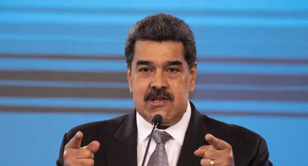 Venezuelan President Nicolas Maduro, gestures while speaking during a press conference at the Miraflores presidential palace in Caracas on February 17, 2021.