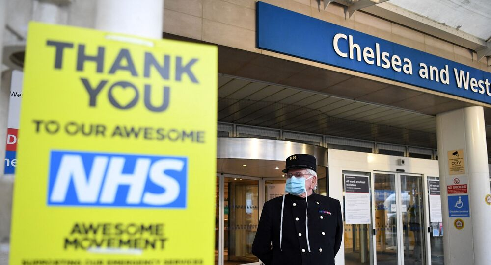 A veteran wearing a Royal Hospital Chelsea hat, and in PPE (personal protective equipment) of a face mask, as a precautionary measure against COVID-19, stands outside the Chelsea and Westminster Hospital in London