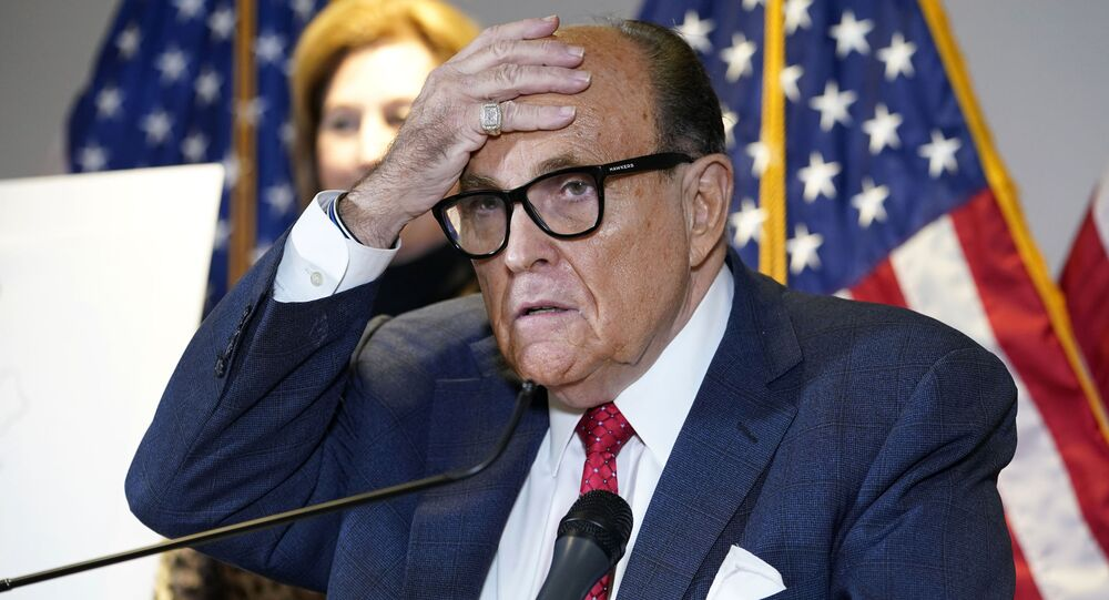 In this 19 November 2020 file photo, former New York Mayor Rudy Giuliani, who was a lawyer for President Donald Trump, speaks during a news conference at the Republican National Committee headquarters in Washington