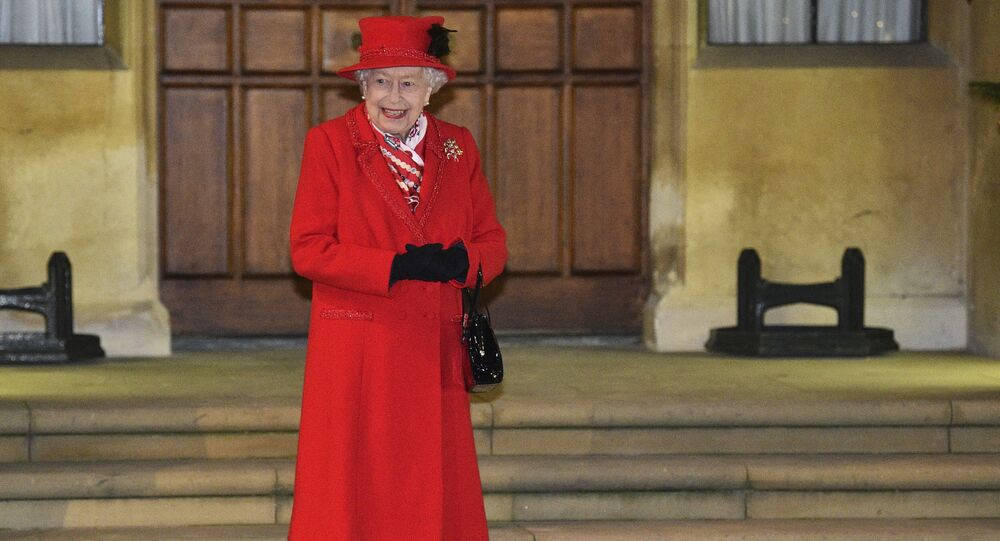 Britain's Queen Elizabeth II, along with other members of the royal family, stands in the quadrangle at Windsor Castle, Windsor, England, Tuesday Dec. 8, 2020, to meet and thank members of the Salvation Army and local volunteers and key workers from organisations and charities in Berkshire.