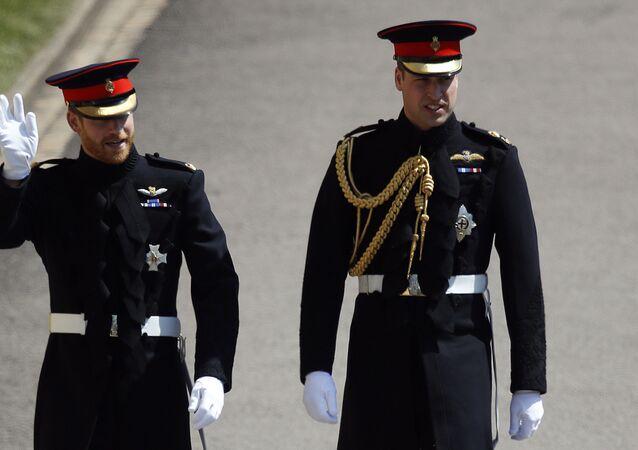 Britain's Prince Harry, left, and best man Prince William arrive for the wedding ceremony at St. George's Chapel in Windsor Castle in Windsor, near London, England, Saturday, May 19, 2018.