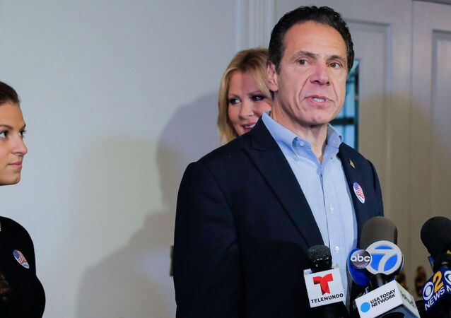Democratic New York Governor Andrew Cuomo speaks at a news conference after voting in the midterm elections, standing with his daughter, Cara Kennedy Cuomo and girlfriend Sandra Lee, at Mt. Kisco, New York, 6 November 2018.