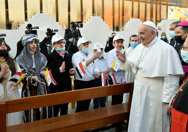Pope Francis greets people as he arrives to hold a Mass at the Chaldean Cathedral of Saint Joseph in Baghdad, Iraq March 6, 2021.