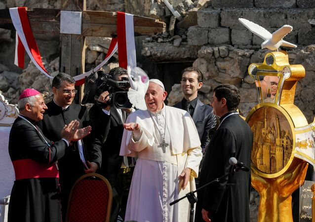 Pope Francis releases a white dove during a prayer for war victims at 'Hosh al-Bieaa', Church Square, in Mosul's Old City, Iraq, March 7, 2021.