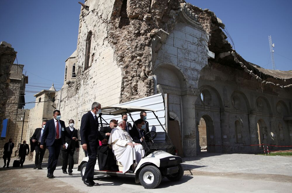 Pope Francis arrives to hold a minute of silence at the destroyed cathedral in Mosul's Old City, Iraq, 7 March 2021.