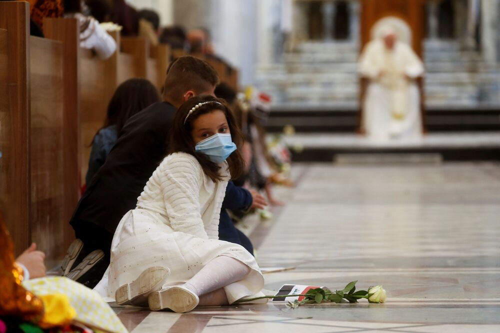 A girl sits down before Pope Francis holds a prayer at the Grand Immaculate Church in the town of Qaraqosh, Iraq, 7 March 2021.