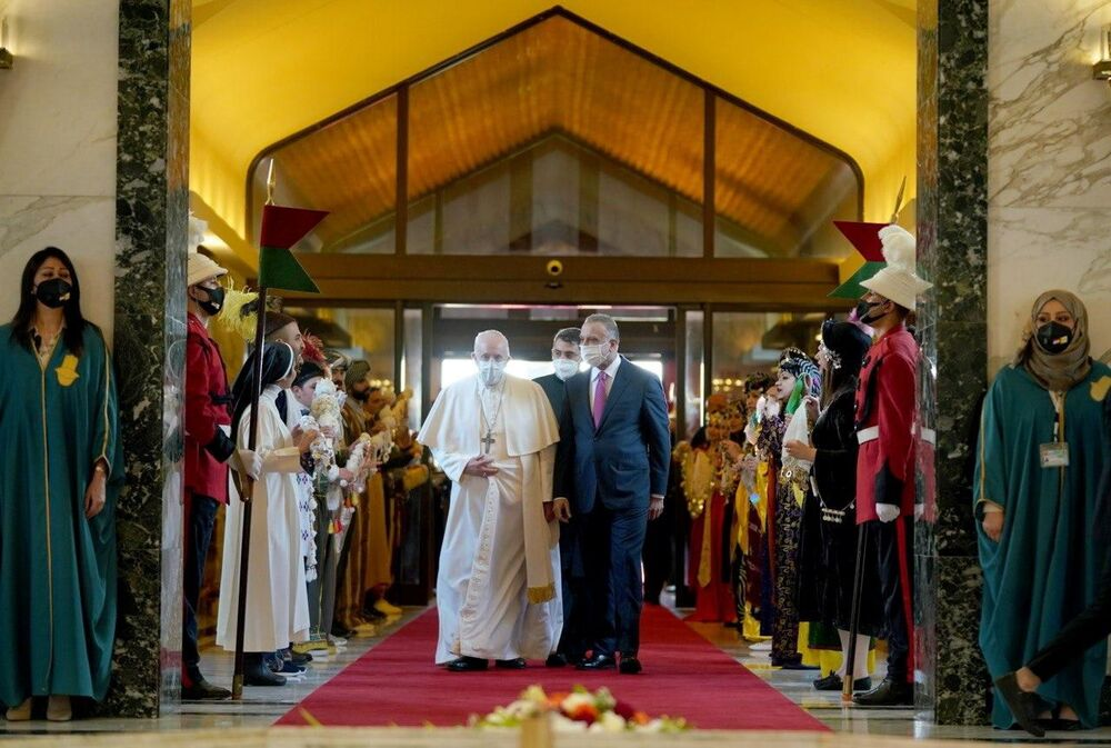 Iraqi Prime Minister Mustafa Al-Kadhimi welcomes Pope Francis at Baghdad International Airport, in Baghdad, Iraq, 5 March 2021.
