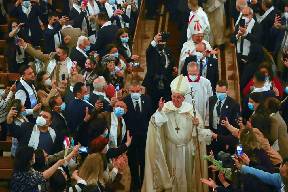 Pope Francis waves as he leaves after holding a mass at the Chaldean Cathedral of Saint Joseph in Baghdad, Iraq, 6 March 2021.