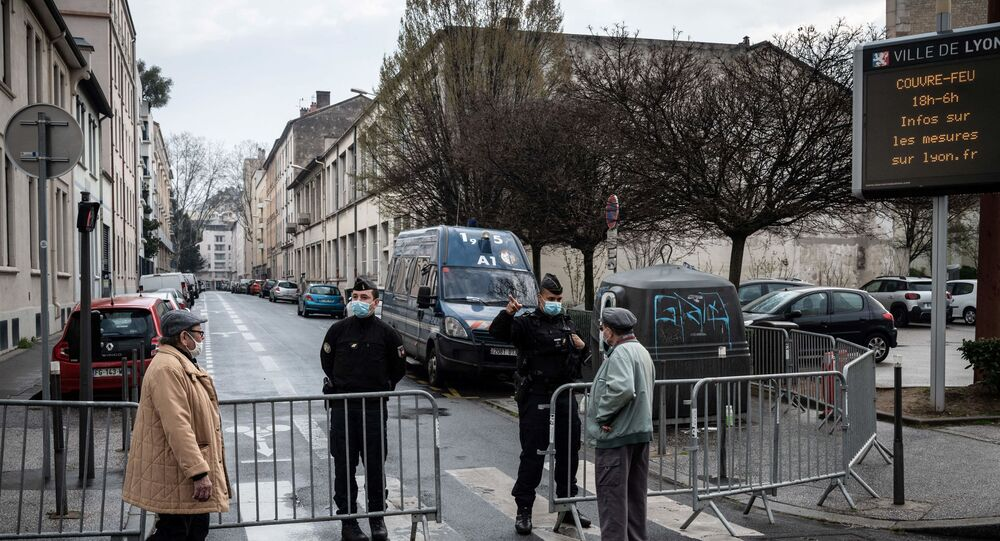 French gendarmes give indications to inhabitants evacuating in the Vaise neighbourhood, in Lyon, on March 7, 2021, in order to allow the defusing of a 230-kilogrammes shell from the Second World War.
