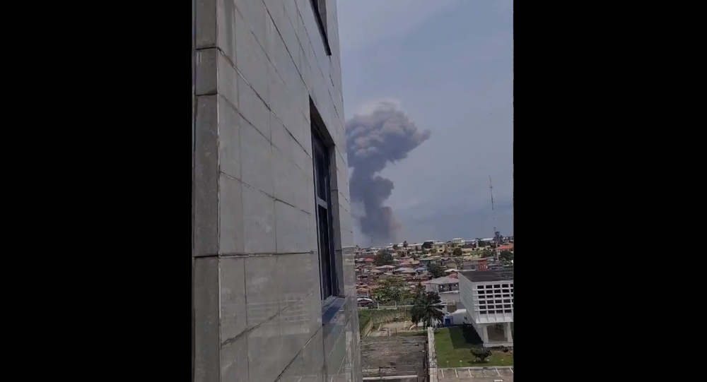 A screenshot from the video allegedly showing the smoke coming from the site of the explosion in Ecuatorial Guinea's city of Bata, posted on Twitter on March 7, 2021