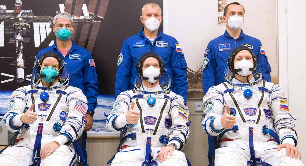 Members of the 64th expedition prime crew to the International Space Station (ISS), NASA astronaut Kathleen Rubins and Roscosmos cosmonauts Sergei Ryzhikov, Sergei Kud-Sverchkov (from left to right) in the front row and members of the 64th expedition backup crew, NASA astronaut Mark Wande Hai and cosmonauts Roscosmos Oleg Novitsky, Pyotr Dubrov (left to right in the second row) before the launch of the Soyuz-2.1a carrier rocket with the Soyuz MS-17 manned transport vehicle from the launch pad # 31 of the Baikonur cosmodrome. Image is a handout provided by a third party.