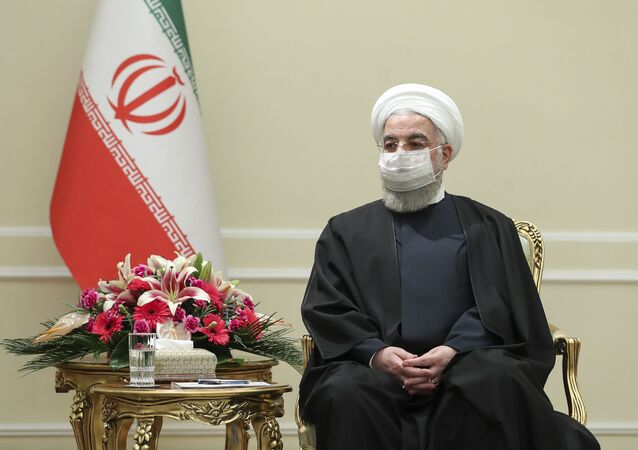 In this photo released by the official website of the office of the Iranian Presidency, President Hassan Rouhani meets with Irish Foreign Minister Simon Coveney, in Tehran, Iran, Sunday, March 7, 2021.