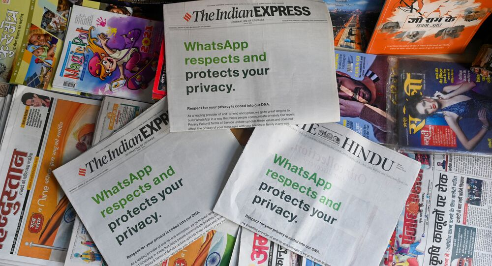 An advertisement from WhatsApp is seen in a newspaper at a stall in New Delhi on January 13, 2021